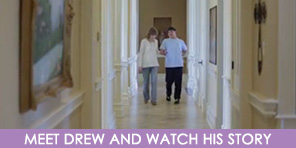 Drew and his mother walking down a hallway